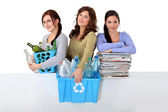 Three girlfriends waste sorting — Stock Photo