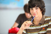 A teenage boy in the classroom — Stockfoto