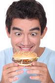 Man holding cheeseburger — Stock Photo