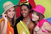 Three female friends with beachwear — Stock Photo