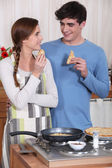 Couple eating pancakes — Stock Photo