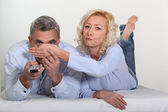 Woman covering her husband's eyes — Stock Photo