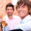 Royalty-Free Stock Photo: Men drinking champagne in a restaurant