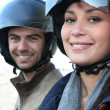 Stock Photo: Couple wearing motorbike helmets
