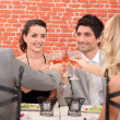 Friends having dinner together — Stock Photo