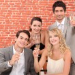 Stock Photo: Business team toasting successful year
