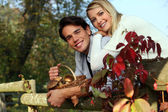 Couple with basket of mushrooms — Stock Photo