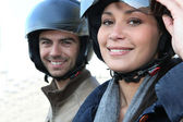 Couple wearing motorbike helmets — Stock Photo