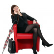 Businesswoman sitting with an umbrella — Stock Photo #10465244