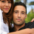 Couple hugging in the park - Stockfoto
