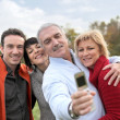 Royalty-Free Stock Photo: Family taking pictures in the countryside