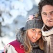 Couple on winter walk through snow — Stock Photo #10467873
