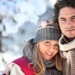 Couple on a winter walk through the snow — Stock Photo