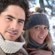 Happy couple on winter walk — Stock Photo #10467876