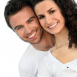 Cheerful couple in front of blue wall — Stock Photo