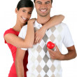 Couple holding a heart — Stock Photo