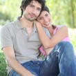 Couple sitting on grass — Stock Photo #10469069