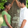 Couple in love stood by tree — Stock Photo