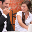 Couple with laptop in restaurant — Stock Photo
