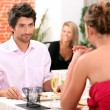 Stock Photo: Couple dining in restaurant