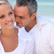 Couple embracing on the beach — Stock Photo #10469989