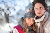 Couple on a winter walk through the snow — Stock Photo