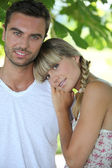 Blond woman leaning on man's shoulder — Stock Photo