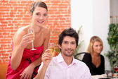 Smart couple drinking champagne at a party — Stock Photo