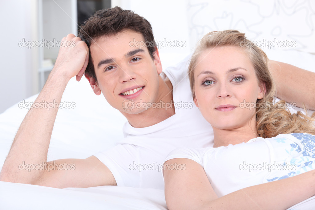 Happy couple laying in bed — Stock Photo #10468233