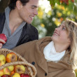Couple with apple — Stock Photo