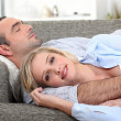 Couple lying on the couch — Stock Photo #10471031