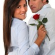 Stock Photo: Couple with a red rose