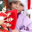 Stock Photo: Little girl playing outside at Christmastime