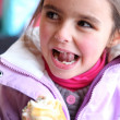 Little girl eating sandwich — Stock Photo #10471934