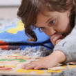 Stock Photo: Child playing with puzzle