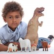 Little boy playing with his toys — Stock Photo #10472696