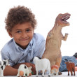 Young boy with his toy animals - Stok fotoğraf