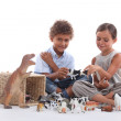Stock Photo: Children playing, studio shot