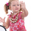 Stock Photo: Girl putting on jewellery