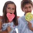 Children with lollipops — Stock Photo