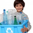 Little boy recycling plastic bottles - Stock Photo