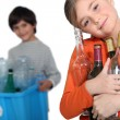 Kids recycling glass bottles — Stock Photo