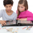 Kids and their stamp collection — Stock Photo