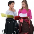 Schoolchildren comparing homework — Stockfoto