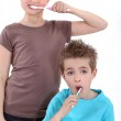 Little boy and girl brushing their teeth — Stock Photo #10474439