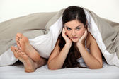 Female and male feet in bed — Stock Photo