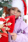 Little girl playing outside at Christmastime — Stock Photo