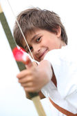 Little boy with bow and arrow — Stock Photo