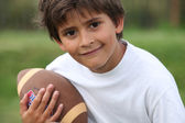 Child with rugby ball — Stock Photo