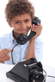 Young boy with an old-fashioned telephone — Stock Photo